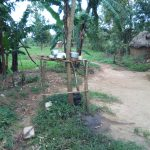 The Water Project: Muyundi Community A -  Dishes Drying On Wooden Rack