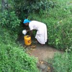 The Water Project: Muyundi Community, Ngalame Spring -  Fetching Water At The Spring