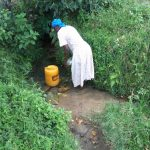 The Water Project: Muyundi Community A -  Filling Jerrycan With Spring Water