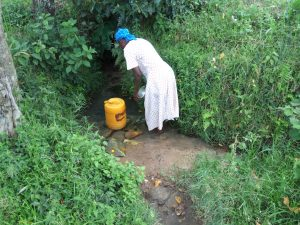 The Water Project:  Filling Jerrycan With Spring Water