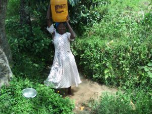 The Water Project:  Hoisting Jerrycan Of Water Onto Head