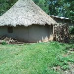 The Water Project: Muyundi Community, Ngalame Spring -  Homestead And Latrine Made Of Banana Leaves
