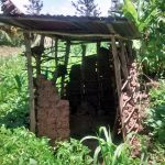 The Water Project: Ewamakhumbi Community, Yanga Spring -  Breaking Down Latrine