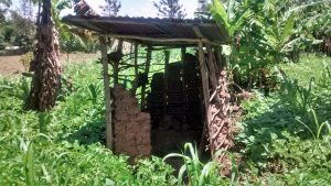 The Water Project:  Breaking Down Latrine