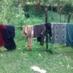 The Water Project: Ewamakhumbi Community, Yanga Spring -  Clothes Hang To Dry