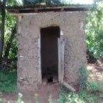 The Water Project: Ewamakhumbi Community, Yanga Spring -  Latrine With Broken Door