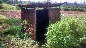 The Water Project:  Mud Walled Latrine