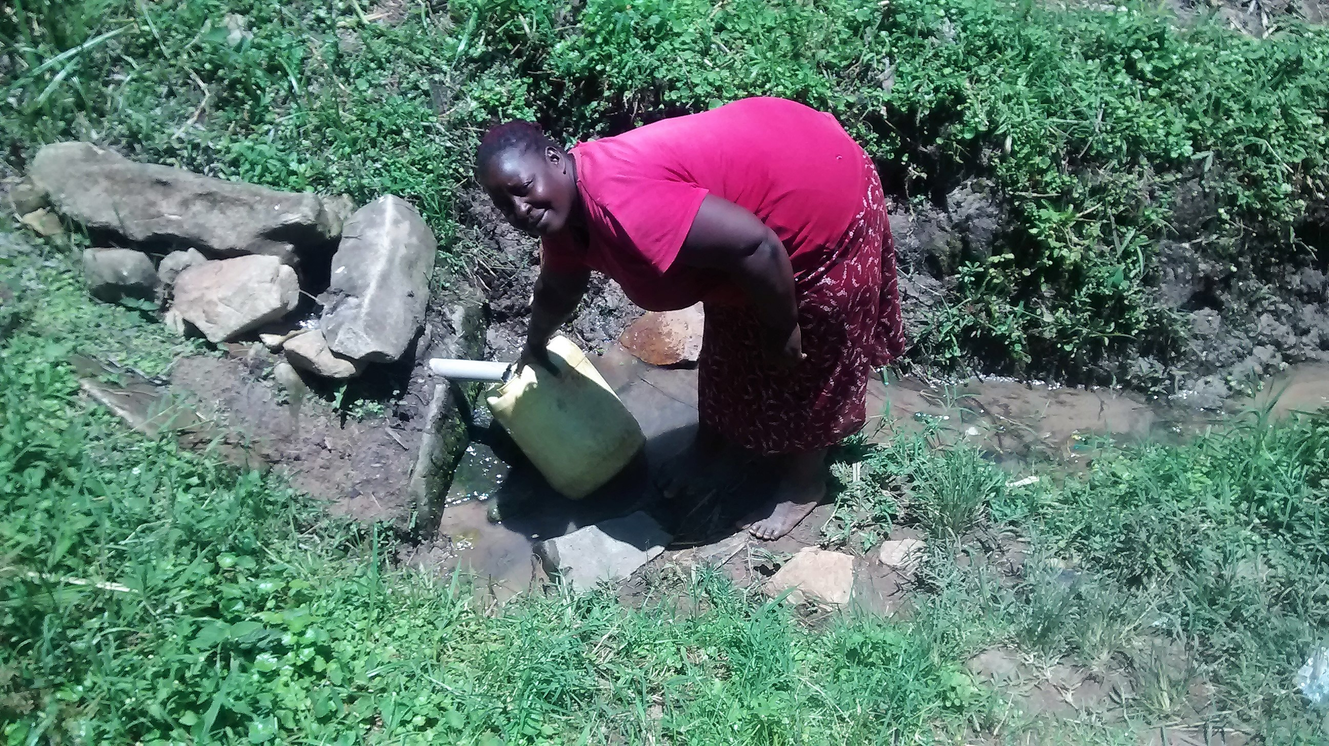 The Water Project : kenya18144-woman-fetches-water-from-the-spring