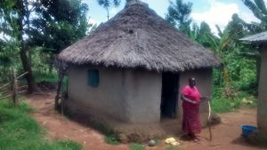 The Water Project:  Woman In Front Of Home