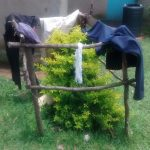The Water Project: Ewamakhumbi Community, Yanga Spring -  Improvized Clothing Rack
