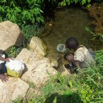 The Water Project: Emachembe Community, Hosea Spring -  Children Collect Spring Water