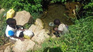The Water Project:  Children Collect Spring Water