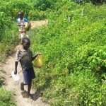 The Water Project: Emachembe Community A -  Children From The Community Heading To The Spring