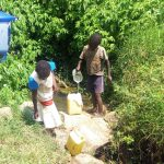 The Water Project: Emachembe Community A -  Pouring Water Into Jerrycan