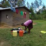 The Water Project: Chegulo Community B -  A Lady In The Community Washes Clothes For Her Family