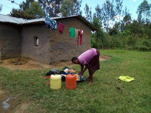 The Water Project:  A Lady In The Community Washes Clothes For Her Family
