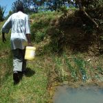 The Water Project: Chegulo Community, Werabunuka Spring -  Carrying Water Home