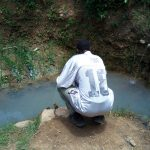 The Water Project: Chegulo Community, Werabunuka Spring -  Fetching Water