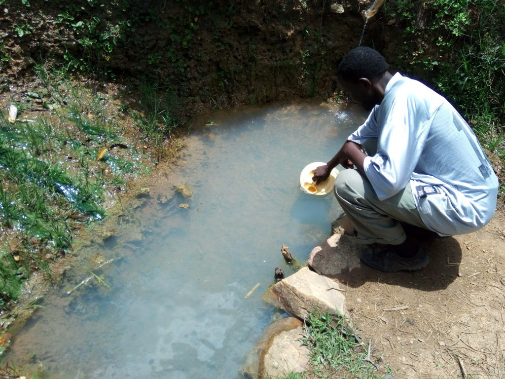The Water Project : kenya18146-fetching-water-at-the-spring