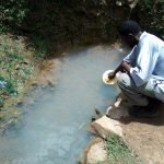 The Water Project: Chegulo Community, Werabunuka Spring -  Fetching Water At The Spring