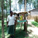 The Water Project: Chegulo Community, Werabunuka Spring -  Mrs Mary Stands By Her Local Shop