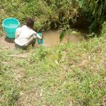 The Water Project: Emaka Community -  A Child Collects Water At The Spring