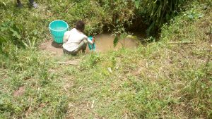 The Water Project:  A Child Collects Water At The Spring