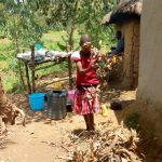 The Water Project: Emaka Community, Ateka Spring -  A Girl Make Firewood At Her Home