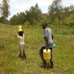 The Water Project: Emaka Community, Ateka Spring -  Carrying Water From The Spring