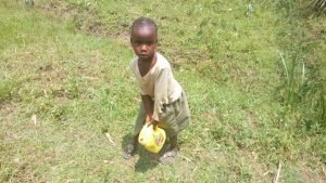 The Water Project:  Child Carries Water Container