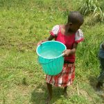 The Water Project: Emaka Community, Ateka Spring -  Children Carry Thier Water Containers From The Spring