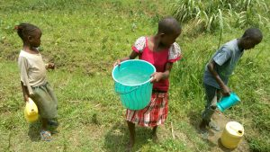 The Water Project:  Children Carry Thier Water Containers From The Spring