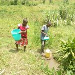 The Water Project: Emaka Community, Ateka Spring -  Children Fetch Water At The Spring