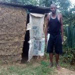 The Water Project: Lunyi Community, Fedha Mukhwana Spring -  A Community Member Stands By His Temporal Latrine
