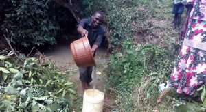 The Water Project:  Pouring Water Into Jerrycan