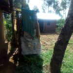The Water Project: Shirugu Community, Jeremiah Mashele Spring -  A Bathroom Made Of Sacks Behind A Households Compound