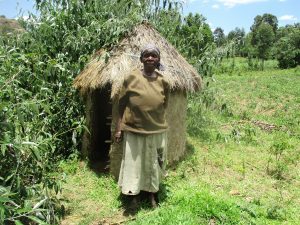 The Water Project:  Belinda Ogutu A Water User Stands Beside Her Grass Thatched Latrine