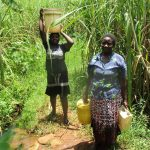The Water Project: Shirugu Community -  Carrying Water Home