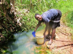 The Water Project:  Filling Container With Water