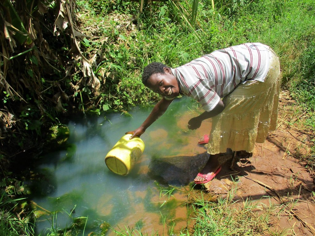 The Water Project : kenya18152-nancy-shakava-fetching-water-at-the-spring