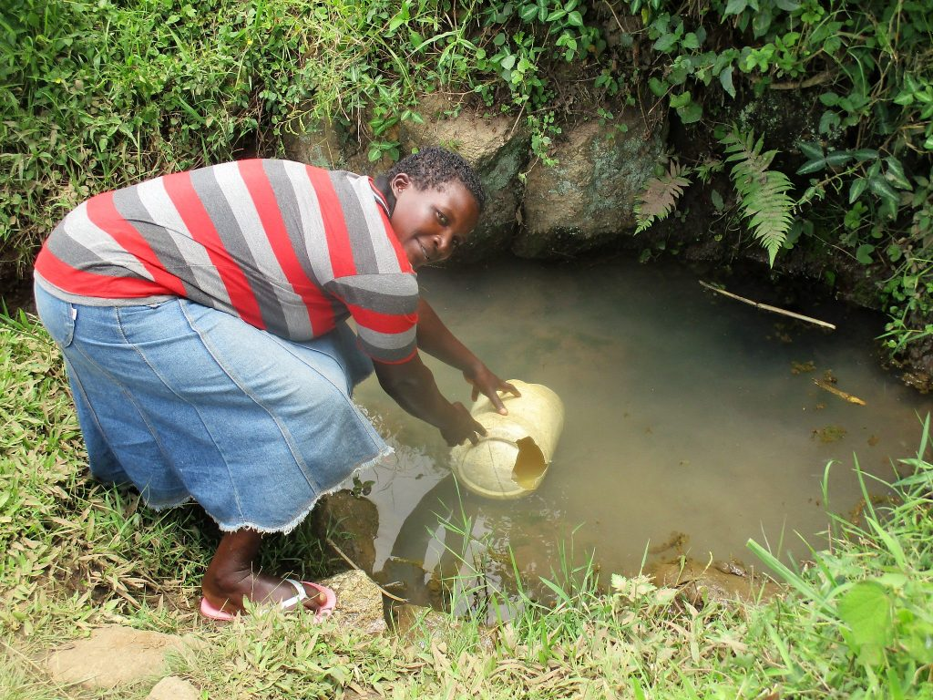 The Water Project : kenya18153-fetching-water-at-the-spring