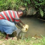 The Water Project: Shirugu Community, Shapaya Mavonga Spring -  Fetching Water At The Spring