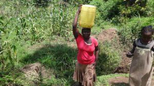 The Water Project:  Carrying Jerrycan Filled With Water On Head