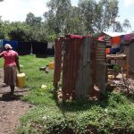 The Water Project: Ematetie Community, Weku Spring -  Returning Home With Water