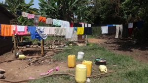 The Water Project:  Water Containers And Cloths Drying On A Clothline