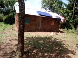 The Water Project:  Clothes And Mattress Dry Atop Home