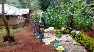 The Water Project:  Clothes Dry On House Line Bushes And Ground