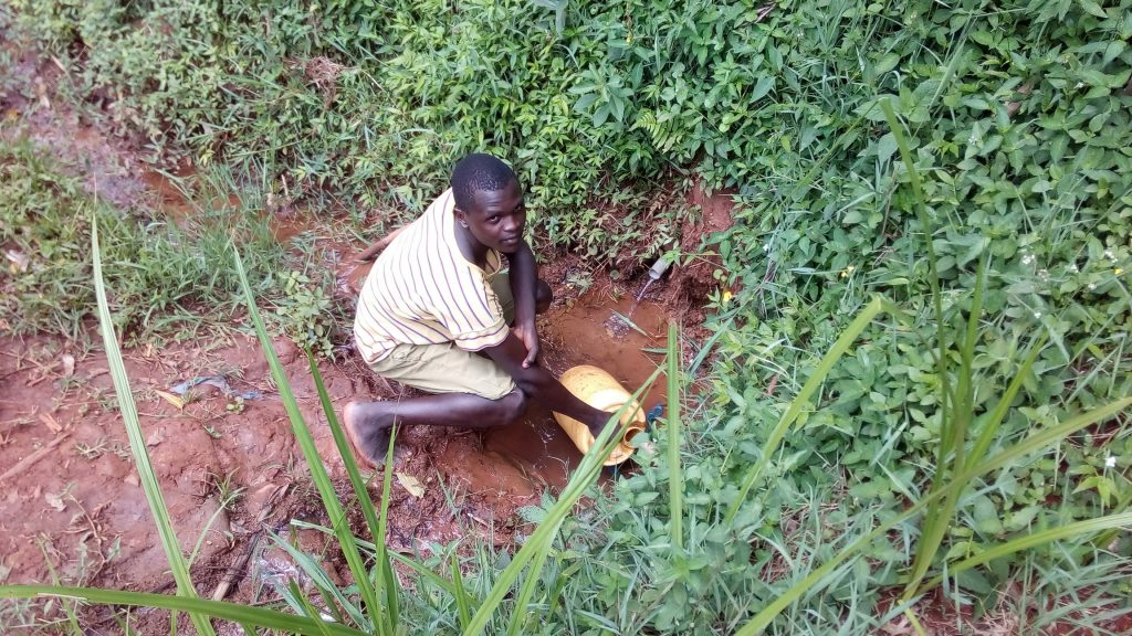 The Water Project : kenya18159-filling-up-jerrycan-at-the-spring