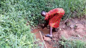 The Water Project:  Girl Washes Her Hands In The Spring