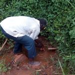 The Water Project: Asimuli Community, John Omusembi Spring -  Mzee Washes Hands At Spring